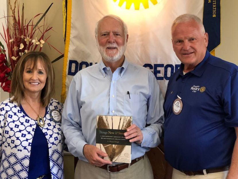 Dr. Clough spoke at the Douglas Rotary Club and South Georgia State  College. He is pictured with Lisa Hodge (left) and Rotary president  Steve Bailey (right) following the Rotary Club meeting.