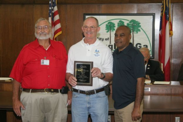 At Monday night's city commission meeting, the mayor and commission recognized Dan Davis for receiving the Mickey Katkaveck Award for Excellence in Park Maintenance Award at the Georgia Recreation and Parks Association District 2 conference recently. Pictured from left are: Roger Johnson, recreation department director; Dan Davis; and City Commissioner Marty Swain.