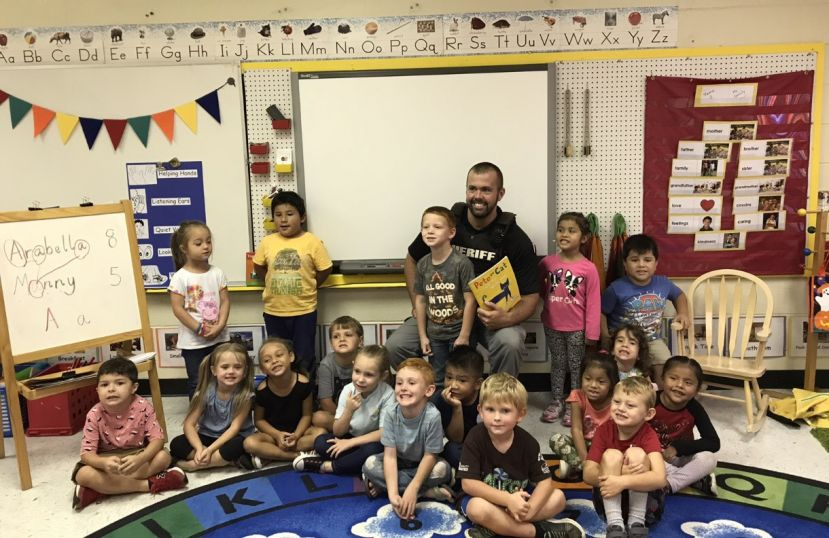 Officer Jarred Horton stopped by for a visit and read a favorite, Pete the Cat: I Love My White Shoes.