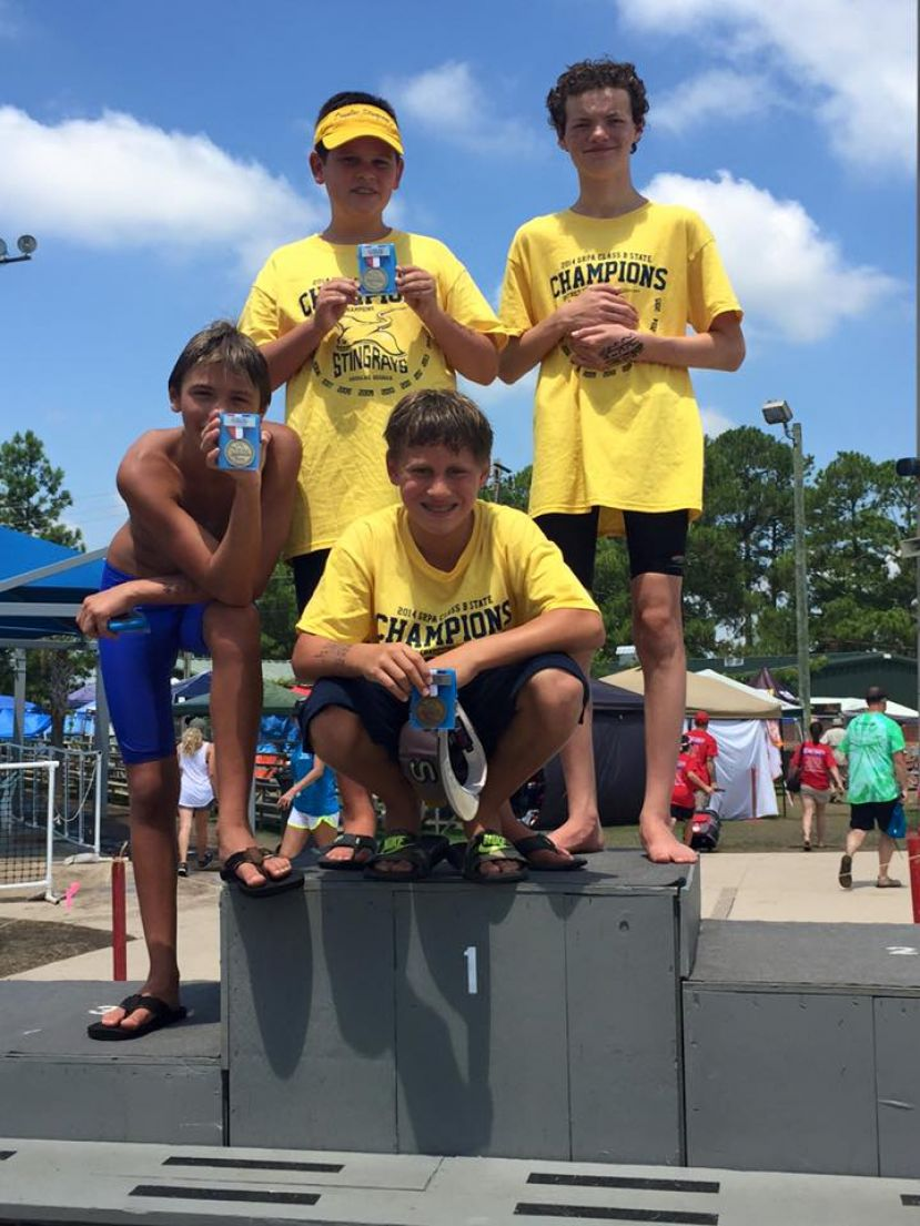 Pictured is the boys 11-12 year old state champion medley relay team: Rhett Robinson, Deuce Ferris, Hogan Doyle, and Andy Lee. Theirs was one of three relay teams that won state titles. Three individual Stingrays also won state championships in their events.