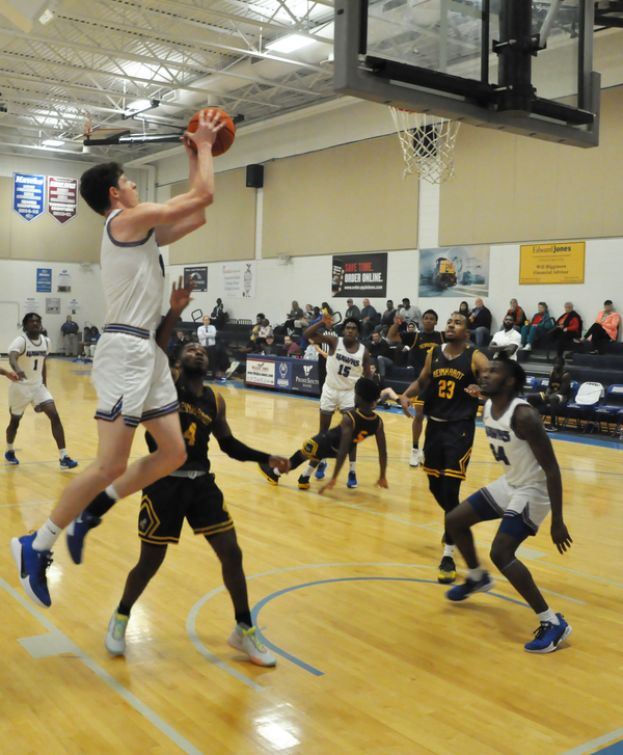 Will Ferguson scores two of his 13 points Tuesday night against Reinhardt University's junior varsity team.
