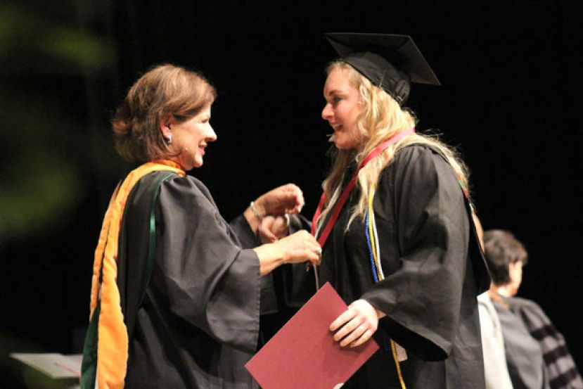 "Jana Wojcik earned her ""sparkly red shoes"" as she graduated from Wiregrass with an Associates in Science in Nursing.  She is pictured here with her ASN Instructor and Director of Nursing at Wiregrass Darlene Ridley"
