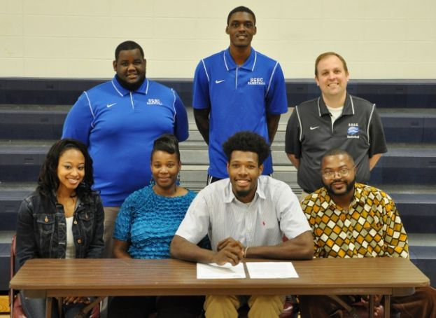 Family, friends, and coaches gathered recently to witness Demontrez Austin's signing with Kennesaw State University.  Front row (L-R): Jasmine Washington, Lametrice Williams, Austin, and Windel Williams.  Back row (L-R): D.J. Hardy, SGSC assistant basketball coach; Josh Mendenhall, SGSC assistant basketball coach; and Cory Baldwin, SGSC head men's basketball coach.