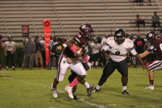 Coffee's Jeremiah Ashley scored on a 48-yard run Friday night against the Richmond High Wildcats. The Trojans won 41-14.