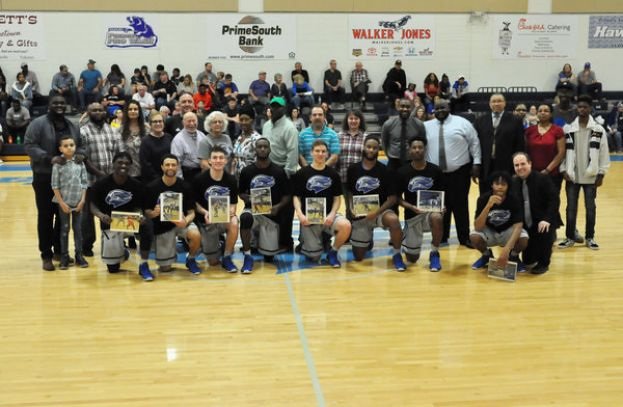 South Georgia State College honored its sophomore basketball players Saturday afternoon in a pregame ceremony. Kneeling (L-R) are Charles Botchway, Keyshaun Street, Luke Lawson, Skyler Baggs, Riley Meloncon, Dewayne Wilson, Kamron Walters and Ellis Wester, Jr.