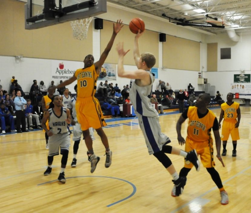 Cody Helgeland tries for a layup Thursday night against Fort Benning.