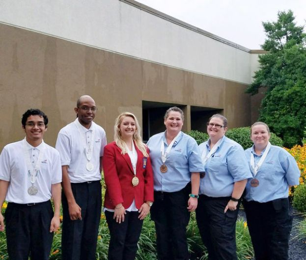 (L-R) SkillsUSA National Silver winners for 3-D Visualization and Animation Allen Paulo and Geremy Brantley, National Gold winner for Esthetics Jamie Grady, and National Bronze winners for Criminal Scene Investigation Shannon Marshall, Donya Land, and Trevecca Gates.