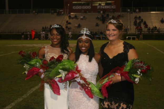 During halftime of the Coffee Trojans' game against the Effingham County Rebels, Javia Manning (middle) was named Homecoming queen. Jazmine Woods (left) and Ruth Day (right) were named princesses.