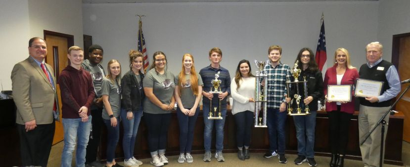 Several of the students representing the Coffee High Band and the Show Choir were present at the meeting with Tania and Steve Myers.  From left to right: Brantley Harper, Tayevion Williams, Jayda Thomas, Kenzie Adams, Cailey Martinez and Gracee Myers. From the Coffee High Band, displaying just a few of their trophies were Kaemon Hersey, Jacque Torres, Connor Adams and Bennett Bush.