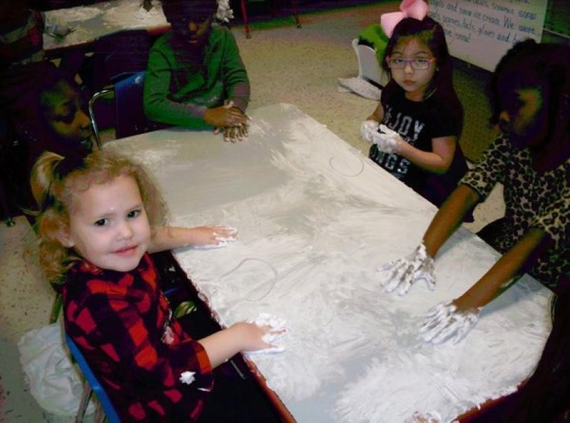 "Shown in the photos are students in Ms. Beverly Barbaree's Pre-k Class enjoying the language and math activity with ""snow""."