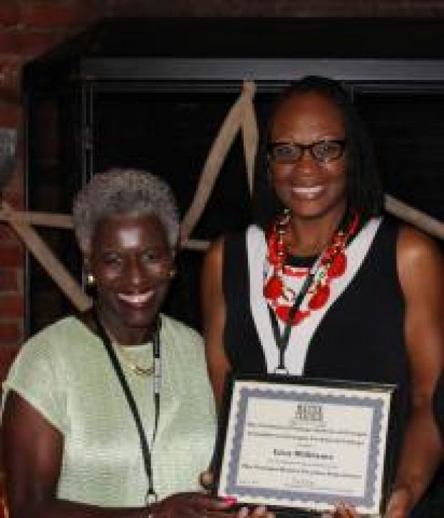 Technical College System of Georgia's Deputy Commissioner Dr. Josephine Reed-Taylor presents Wiregrass Instructor Dr. Lisa Williams with a completion certificate for the 2014 Georgia Master Teacher Experience.