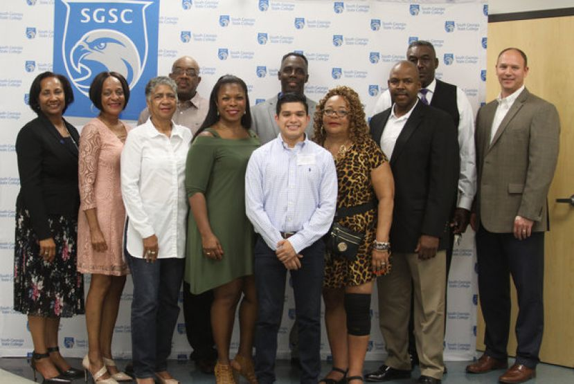The SOBU Alumni are shown here with recipient, Antonio Rivera, as well as Dr. Ingrid Thompson-Sellers, SGSC President, and Mr. Chris Tuten, SGSC Foundation President; this year's scholarship has been dedicated to the memory of their classmate – Ms. Brenda Blue.