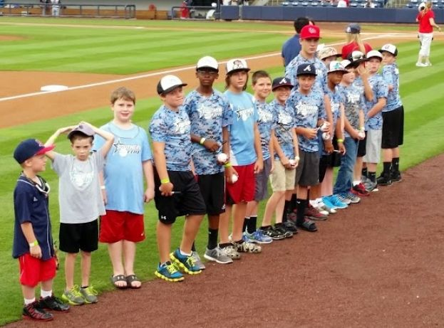 "Southern Elite team members prepare to be honored as ""Team of the Night"" at the Gwinnett Braves game Friday, June 27, prior to their participation in the Final Four tournament over the weekend in McDonough."
