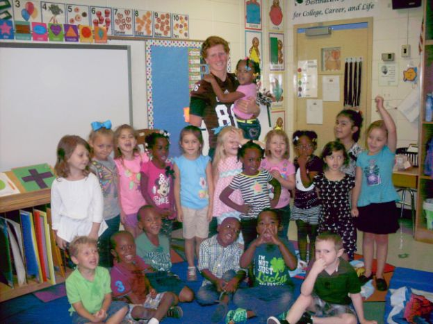 Adopted Trojans visit their classrooms at Eastside Elementary