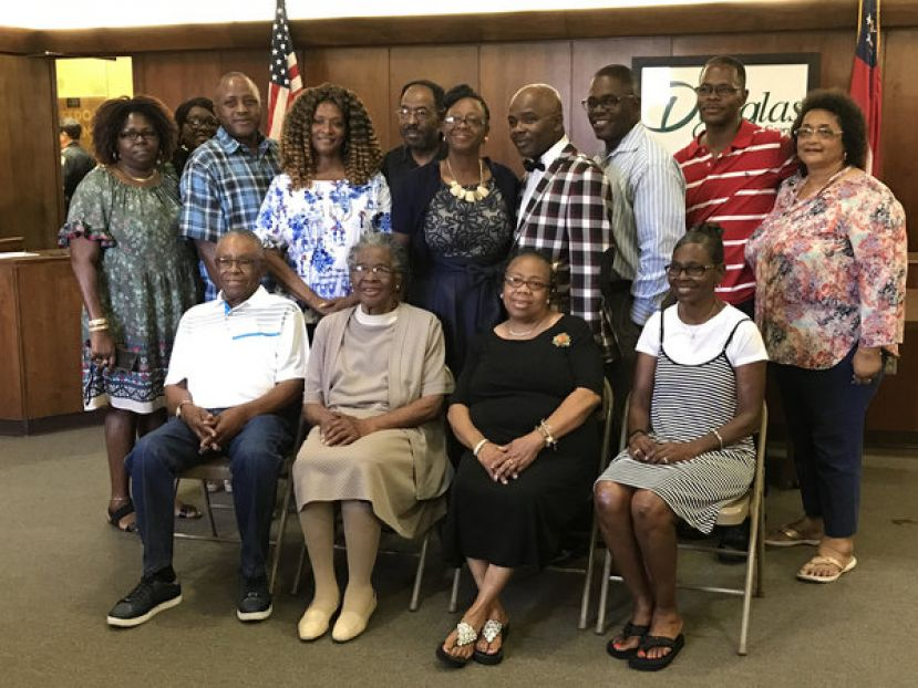 Back: Debra Taylor, Barbara Anderson, Nathan Taylor, Lois Shaw, Louis Colson, Bobbie Jean Taylor, Ward 1 Commissioner Edwin Taylor, Dexter Taylor, Connie Mack Taylor, Patricia Grady Front: Father Sam Taylor, Aunt Susie Taylor, Virginia Newton, Mary Gail Massey