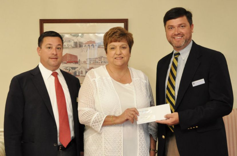 John Hereford (right), president of Miles-Odum Funeral Home in Waycross, recently presented a contribution on behalf of the company to the James M. Dye Foundation on South Georgia State College's (SGSC) Waycross Campus. Accepting the contribution was Foundation Treasurer Cindy Sowell