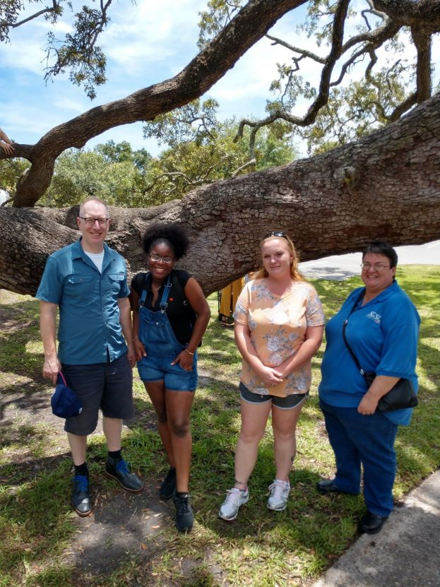 Dr. Thomas Agostini, SGSC assistant professor of history, Victoria Wyatt, a dual enrolled student from Waycross, Ga., Kelly Griffis from Patterson, Ga., and Sandra Adams, SGSC interim dean of students and housing, take time on their trip to view one of the massive oak trees located on St. Simons Island.