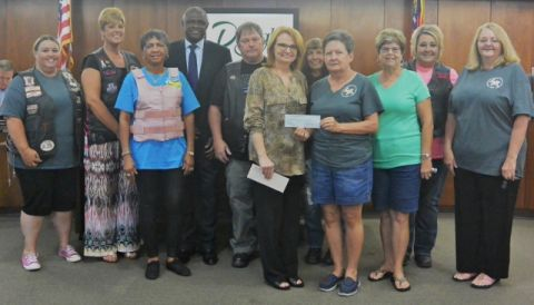 Motorcycle committee presents donation to Childhood Cancer Awareness Group of Coffee County