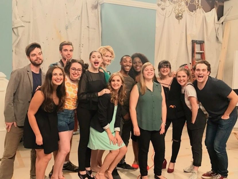 Anna Braswell (front row, green sleeveless shirt) stands with the cast and crew of Nailed It!, a sitcom she created, wrote, and produced and for which she won a student Emmy.