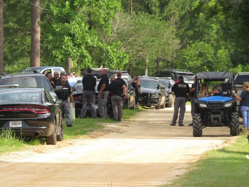 Officers from across the community gather Friday in West Green to search for a missing child.