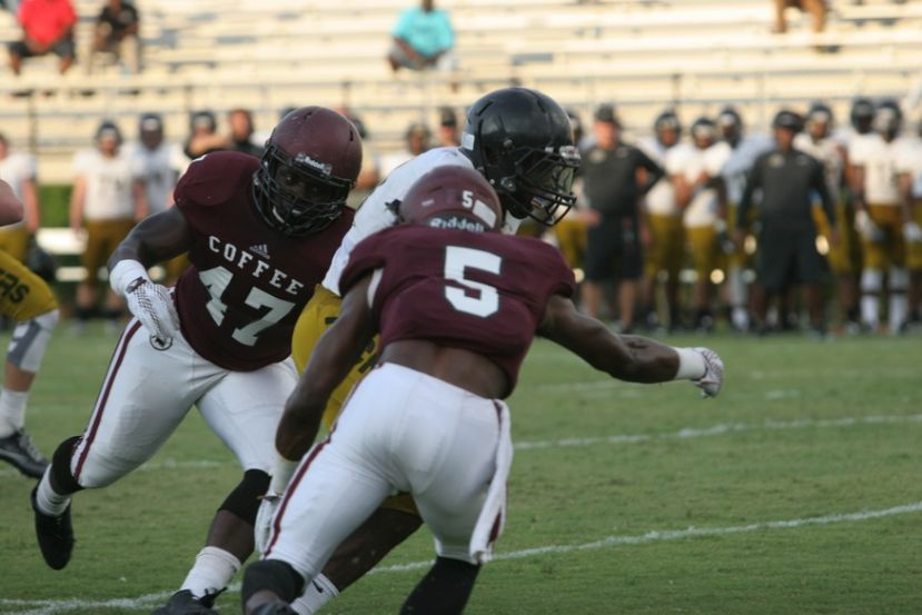 Jameon Gaskin (47), seen here in last year's scrimmage against Colquitt County playing linebacker, scored three touchdowns and sacked the Effingham quarterback for a safety in the Trojans' 35-20 win in the Erk Russell Classic.