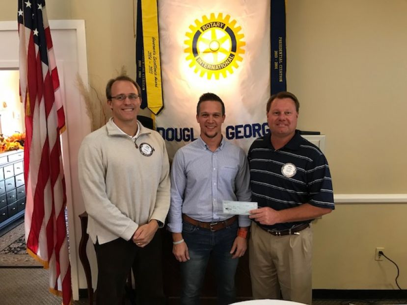 John Day (left), Archie Rish (center), and Rotary president Greg Miller (right)