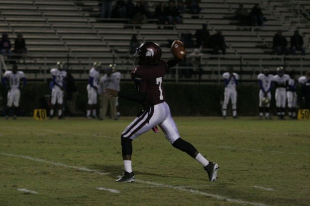 Coffee High quarterback Tyree Paulk threw three touchdown passes in the Trojans' 42-0 win over the Bradwell Institute Tigers Friday night.