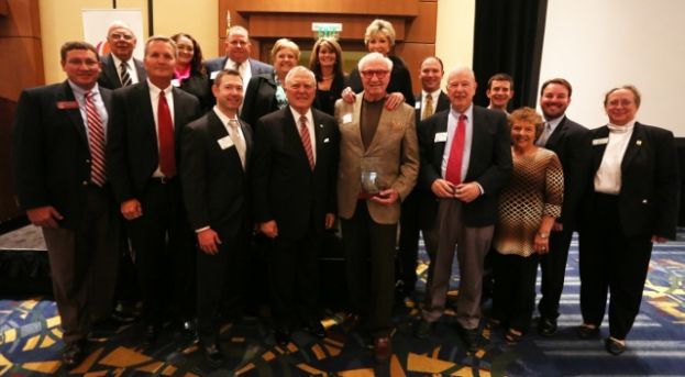 Local philanthropist and developer Francis Lott receives the GEDA Volunteer of the Year award at the association's November annual awards luncheon. Pictured are, front row (L-R), incoming State Rep. Dominic LaRiccia, Stuart Smith, Adam Smith, Governor Nathan Deal, Francis Lott, Garland Thompson and Judy Dennis.  Back row (L-R) Mayor James Dennis, Andrea Taylor, Stanley Lott, JoAnne Lewis, Lidell Greenway, Diane Lott, Chris Tuten, Michael Lott, J.R. Charles and Saralyn Stafford.