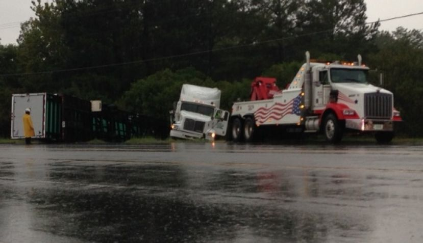 Tractor-trailer overturns on U.S. 441