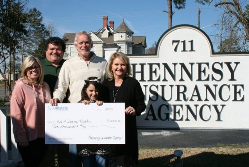 The Nadler family is pictured with Jeff and Kellye Hennesy holding their $10,000 check from Allstate.