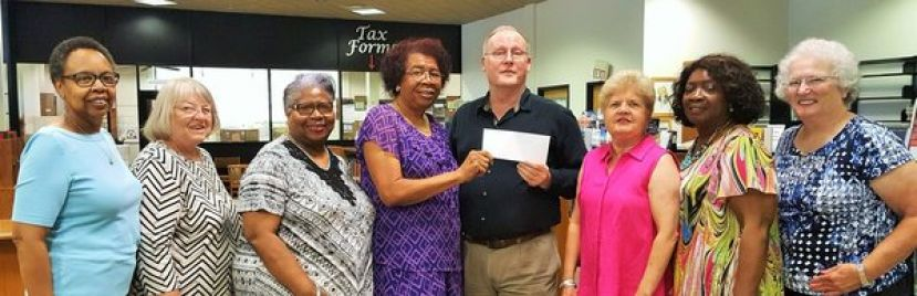 CAREA makes presentation to Satilla libraries. Yvonne Clay, Betty Anne Smith, Virginia Tomlin, CAREA Library Chairman Leola Johnson, Library Director Mark Cole, CAREA President Elizabeth White, Jessie Porter and Evon Floyd.