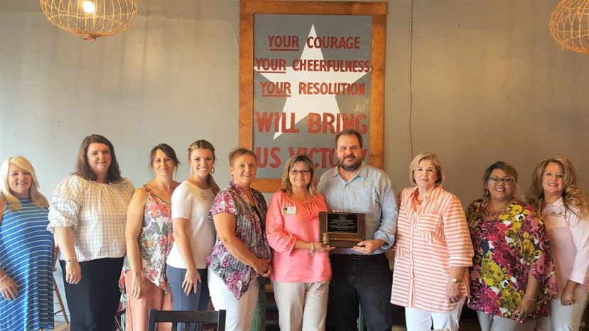 MMTA President Blondale Thomas presents Franklin Dismuke (Eagle Creek Brewing Company) with a plaque of appreciation for his service as 2018-2019 President of the travel association during the meeting in July at the Shoppes on 4th & Cherry in Ocilla, Georgia.  (L-R) Sonya Miller (Hazlehurst-Jeff Davis Chamber), Brandy Elrod (Fitzgerald CVB), Daphne Walker (Lyons Main Street), Jennifer Surrency (Douglas-Coffee County Chamber), Paula Anderson (Telfair County Chamber), Blondale Thomas (City of Douglas), Franklin Dismuke (Eagle Creek Brewing Company), Cathy Stott (Ocilla-Irwin Chamber & EDA), Georgia Henderson (City of Douglas), and Paula McCain (Eastman-Dodge County Chamber)