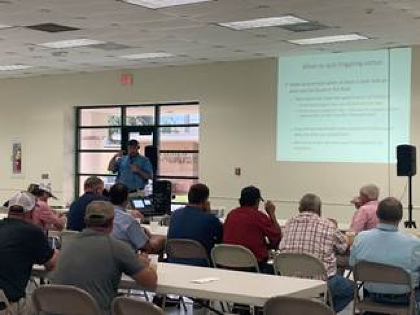 Jared Whitaker, UGA Extension Cotton Agronomist, speaks to cotton producers about cotton defoliation strategies.