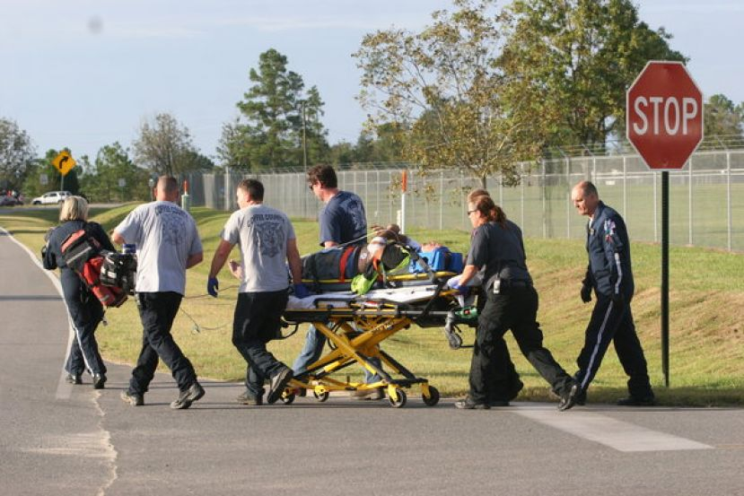 First responders transport the accident victim to a waiting helicopter following an accident Saturday at Premium Peanut.