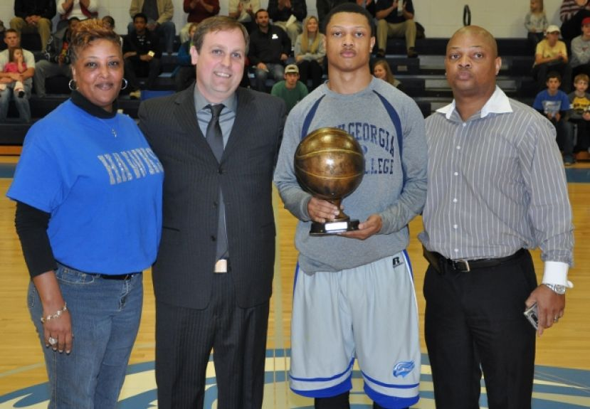 Jovante' Spivey was recognized before the game Wednesday night for scoring 1,000 points in his career at SGSC.  Pictured (L-R) are mother Nicole Spivey, Cory Baldwin, Jovante' Spivey, and father Anthony Spivey.