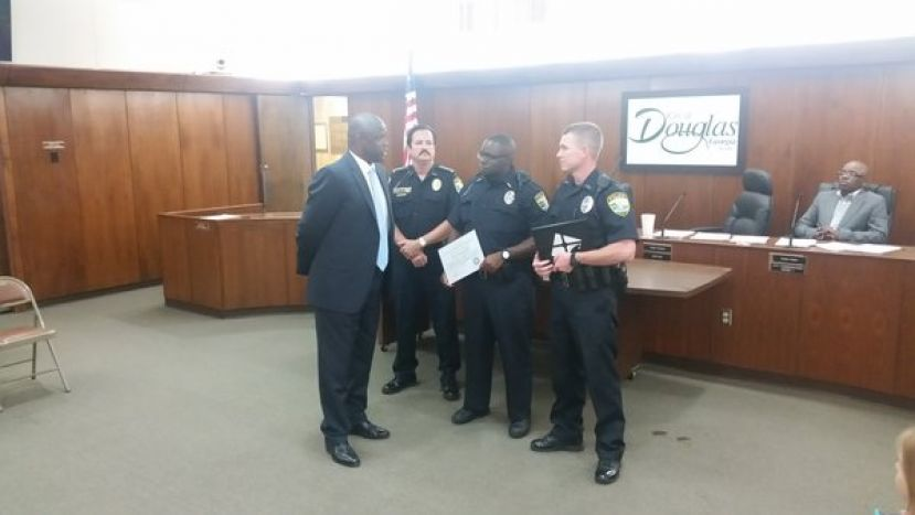 Mayor Tony Paulk recognizes new Douglas police officers Gregory Toler and Ashley Wilson. Officers Toler and Wilson just graduated from the Tifton Regional Police Academy