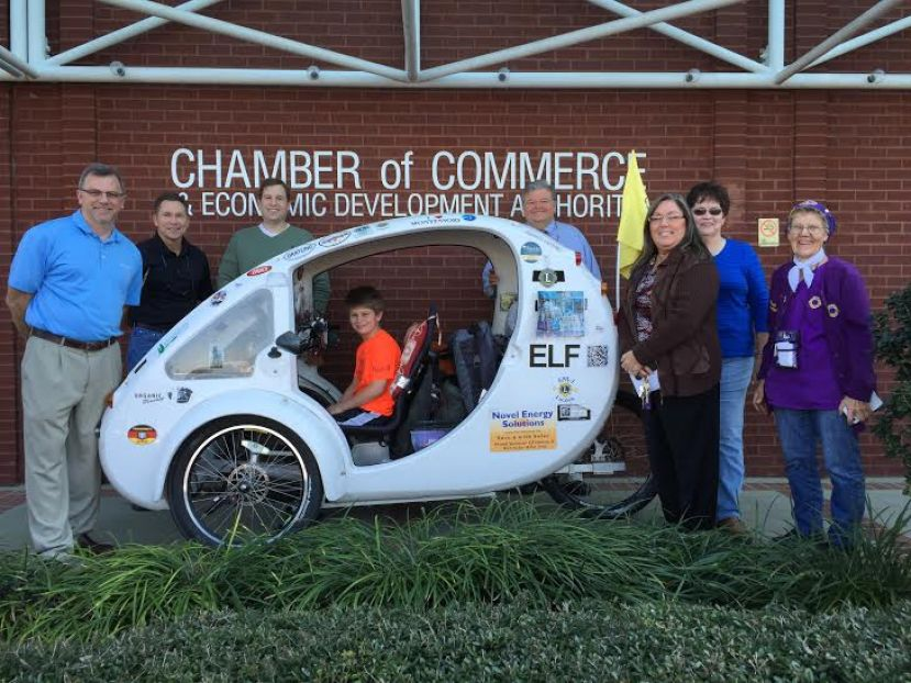 From left: Douglas Lions Club president Phillip Smith, Andy Thomas, Donnie Bradshaw, Dewey Hayes, Cathy Threatt, Lynn Lucas, and Hanna Elshoff stand next to Elshoff's solar/battery/human-power ELF vehicle in front of the Douglas-Coffee County Chamber of Commerce building Thursday afternoon. Zean Preston is sitting inside the ELF.
