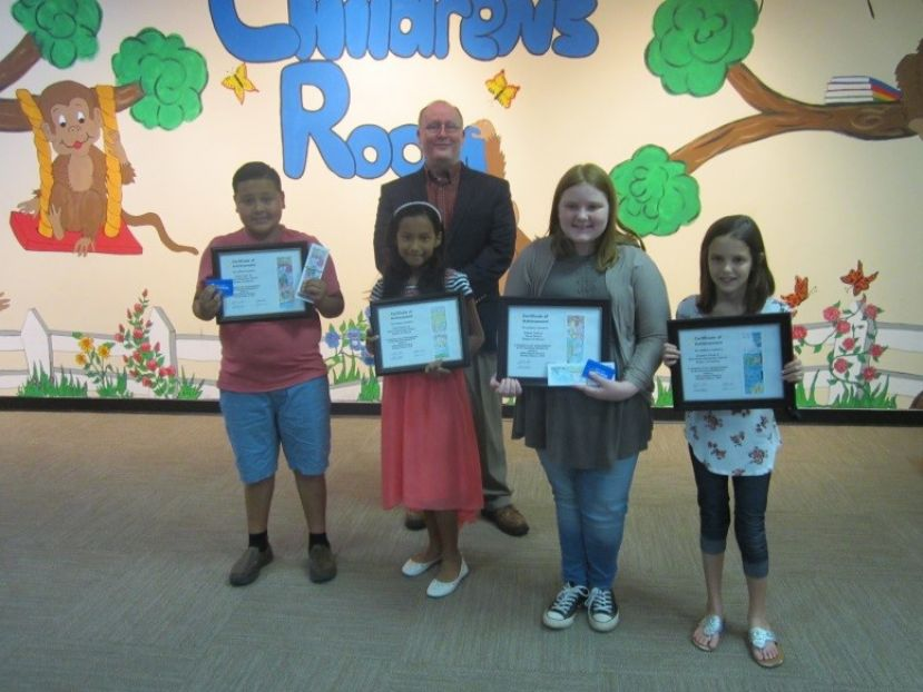 Front Row: (Left to Right): Javier Taylor, 5th Grade, Pearson Elementary School, Aylee Centeno, 4th Grade, Pearson Elementary School, Dakota Thrift, 6th Grade, Home School, and Langston Camp, 4th Grade, West Green Elementary School.  Back Row: (Left to Right): Mr. Mark Cole, Director. Not Pictured: Nyla Stewart, 9th Grade, Wiregrass Regional College and Career Academy, Aidan Brown, 9th Grade, Atkinson County High School