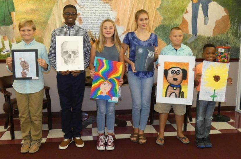 Pictured from left to right: Jake Grantham from Indian Creek Elementary; Kevis Washington, Jr., from George Washington Carver Freshman Campus; Gracy Floyd from Nicholls Elementary; Kaitlyn Anderson from Coffee Middle School; Jake Johns from Ambrose Elementary and Jayvion Dent from Broxton Mary-Hayes Elementary.