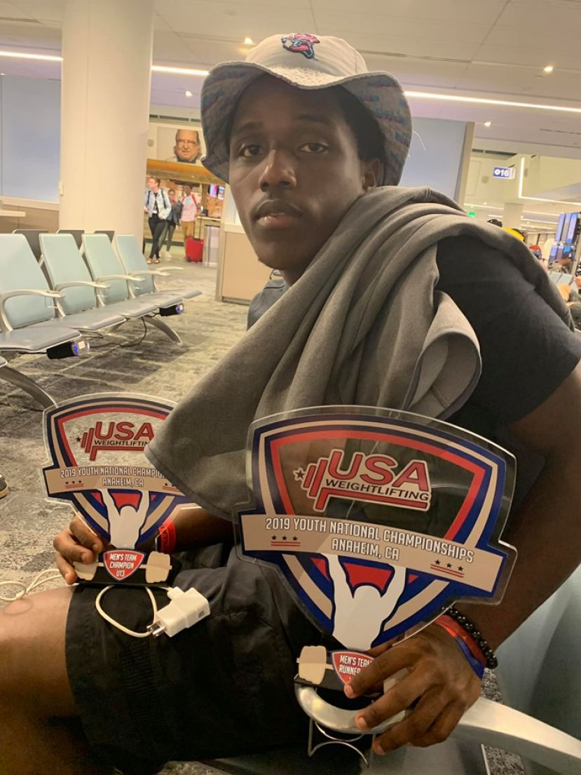 Arlis Sutton, who won bronze in the clean and jerk in the 16-17 96 kilo division, shows off Team Divergent's national championship trophy from the USA Weightlifting Youth National Championships in Anaheim, California. The meet wrapped on Sunday, June 30, 2017.