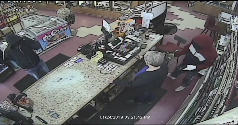 Deputies are looking for the two individuals seen here robbing Evans Grocery at gunpoint on Thursday, Jan. 24, 2019.