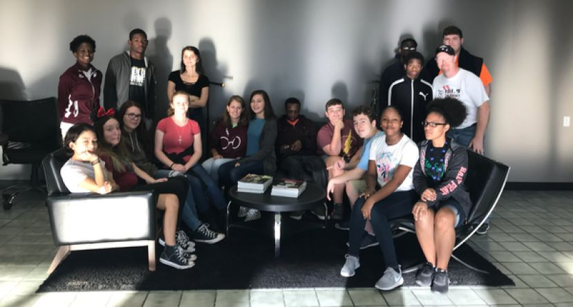 George Washington Carver Freshman Campus Journalism class pictured with DJ Paul Sullivan before they tour Broadcast South