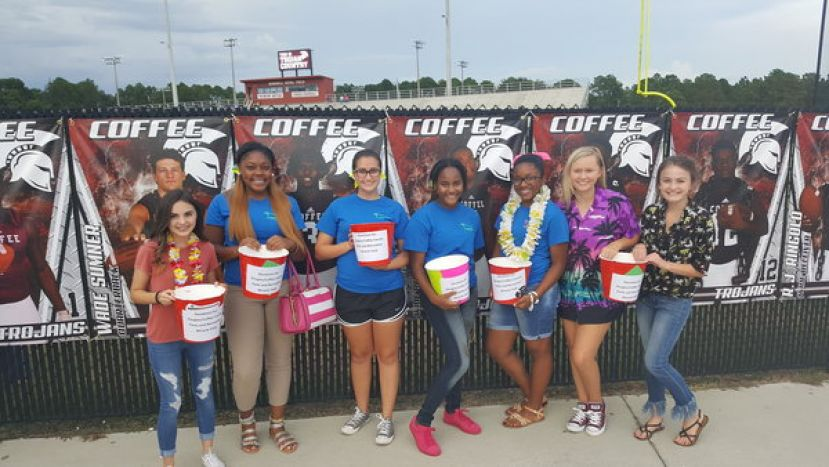 Cheerleaders help to collect donations for DCCPRD Miracle Field at Trojan game