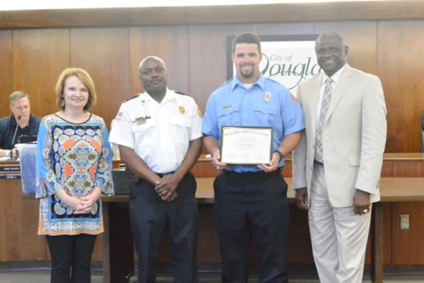 (L-R): Commissioner Cindy McNeill, Fire Chief Larry Wilson, Firefighter William Thompson, and Mayor Tony Paulk.