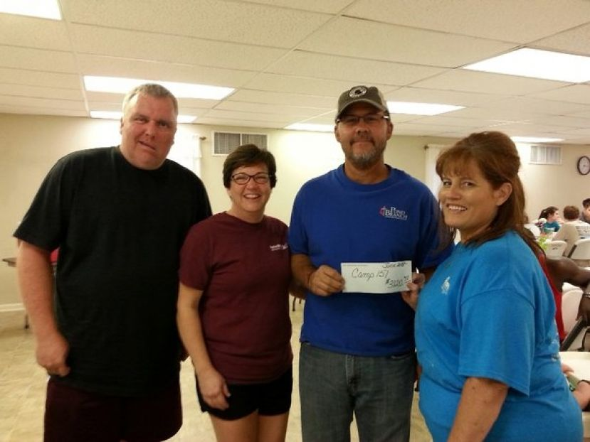 Mike Lord, Dana and Chris Calhoun (Camp 151) accepting check from Margie Sayer (FCCC)