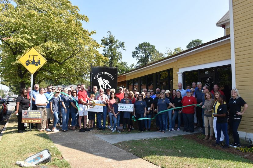 Cow Tippers holds ribbon cutting