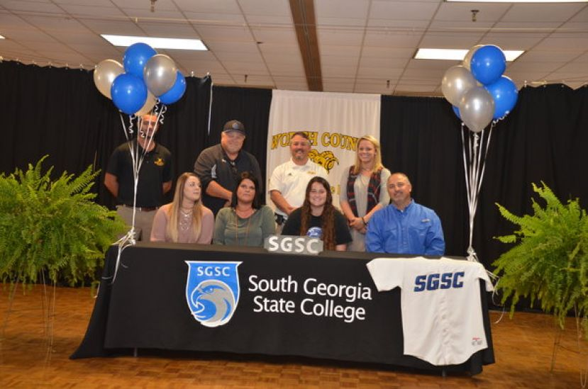 Brinsley Graddy and Kailey Parr sign to play softball with the SGSC Hawks after graduating from Worth County High School.