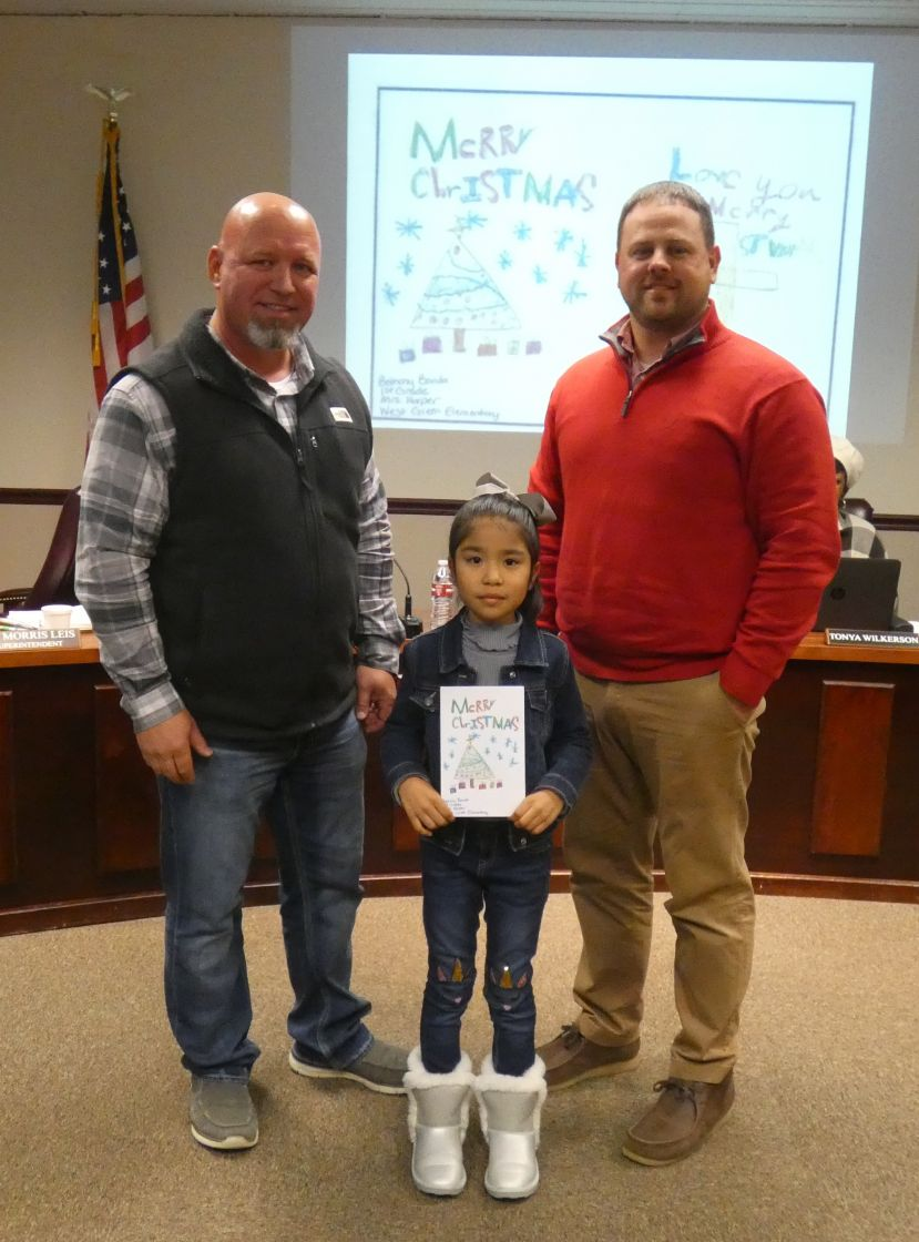 Pictured from left to right: Andy Varnadore, representative from Satilla REMC; Aaliyah Jordan, third grader from West Green Elementary; Alan Chancey, principal from West Green Elementary; Not pictured: Bethany Banda, first grader from West Green Elementary