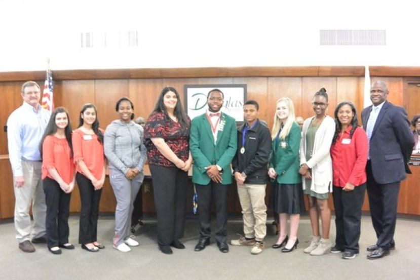 (L to R): Mr. Kevin Tatum (County Extension Coordinator), Alexandra Rivero, Ishika Sadarangani, Amelia Crockett, Savannah Cothern, T.K. McIver, Micheal Woods, Evie Woodward, Kyya Johnson, Mrs. Chalanda Woods (AmeriCorps Member), and Mayor Tony Paulk.