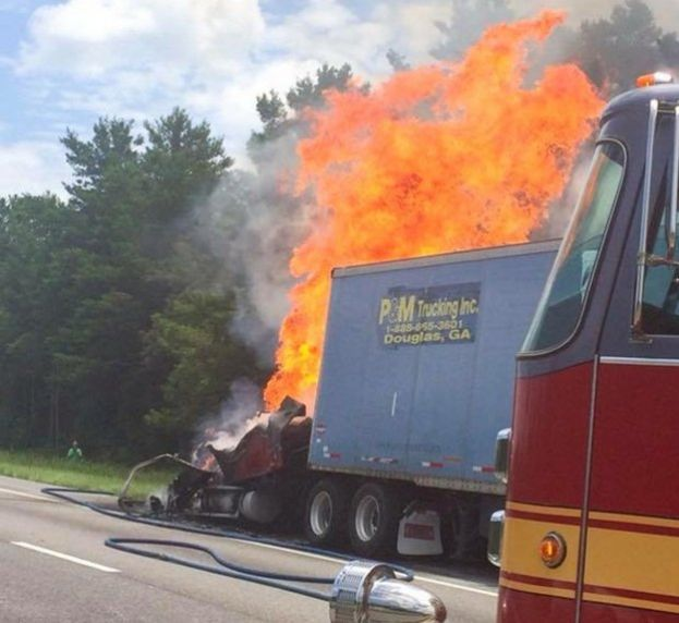 A truck leased LEM Trucking in Douglas burns on the side of I-10 in western Florida. The P&M trailer behind the burning truck was allegedly stolen.